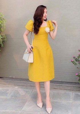 Những mẫu áo - đầm màu vàng chanh nổi bật hè này